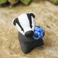 Badger with blue flowers