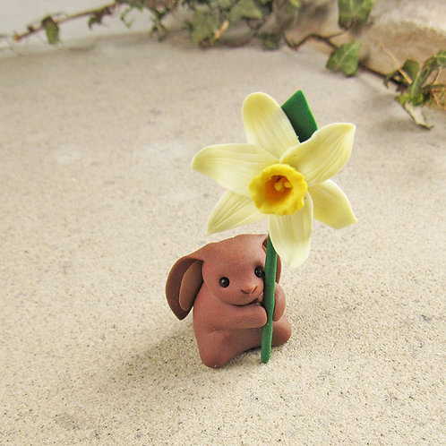 Cute rabbit ornament with daffodil