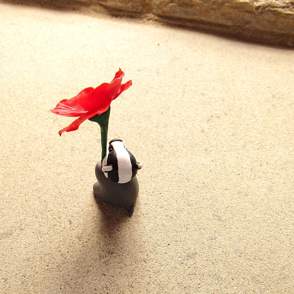 Tiny badger ornament with red poppy
