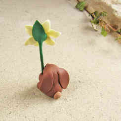 Rabbit holding a daffodil