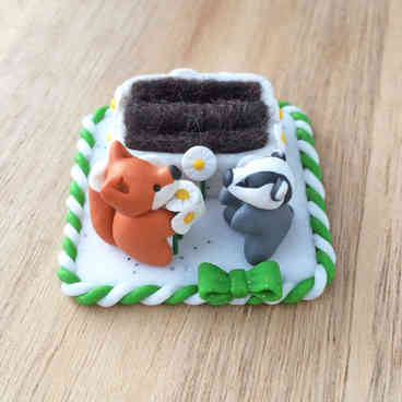 Fox and badger double ring holder