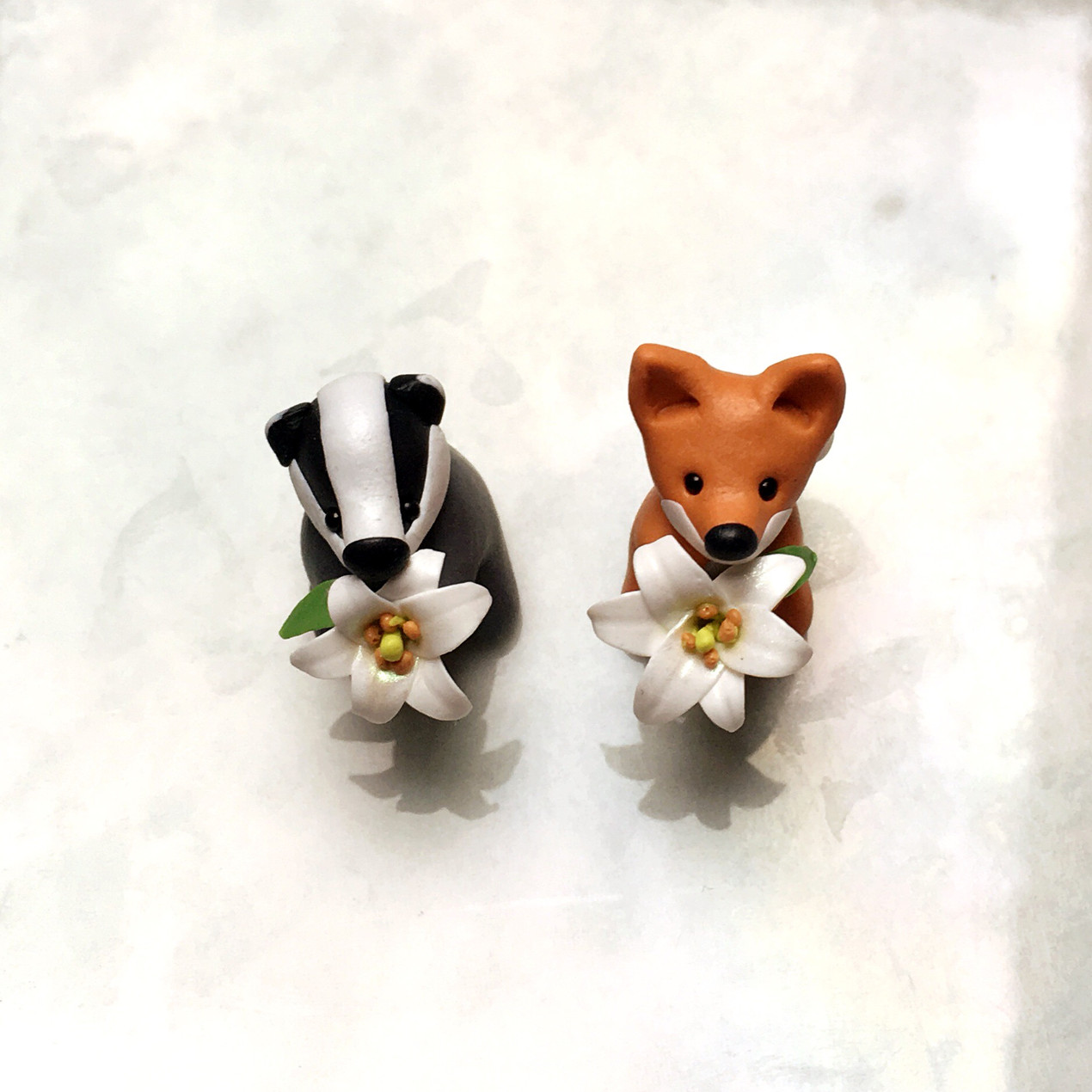 Fox and badger with lilies