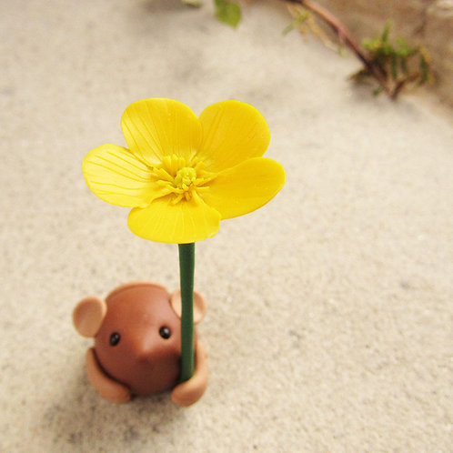 Tiny mouse ornament with yellow buttercup flower
