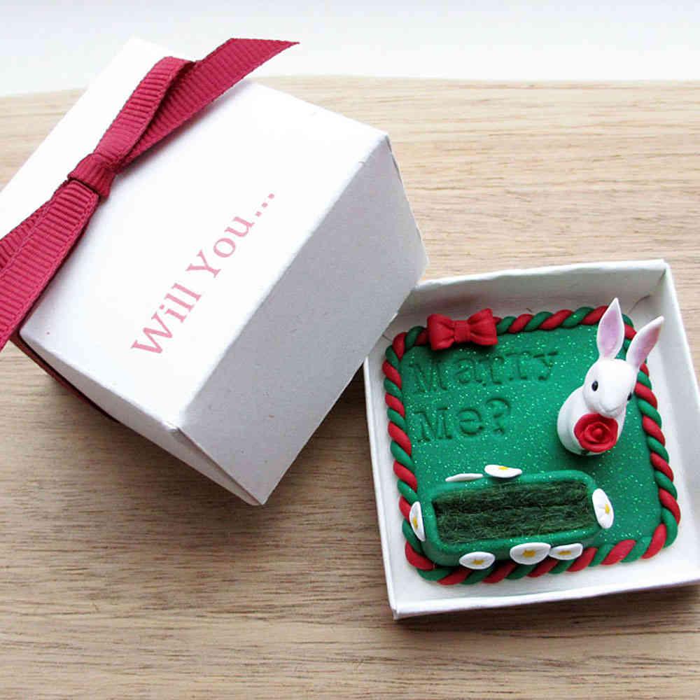 White rabbit engagement ring holder