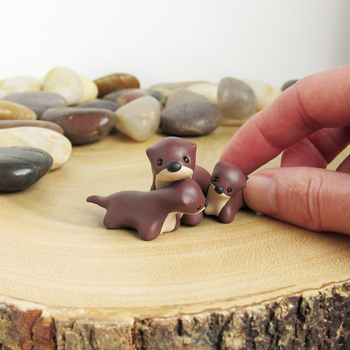 Otter family ornament