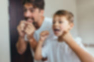 Dad and Son Flossing.jpg
