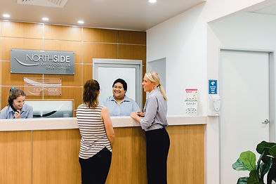 Brisbane Northside Orthodontist receptionists speaking with a patient