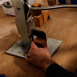 A block of wood is split to make fire starter