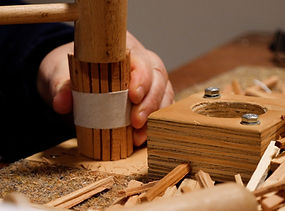 Hand holds a fire starter while hammering the top