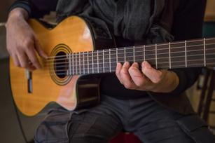 Saverio playing his guitar
