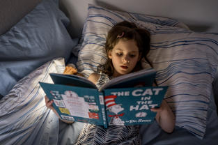 Post diagnosis reading: a rare visual of her proactively reading a book out loud