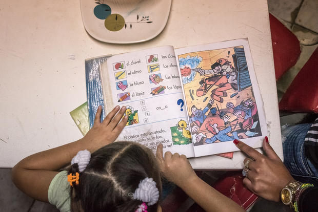 Inside a home in Havana, a page from a young girl's homework