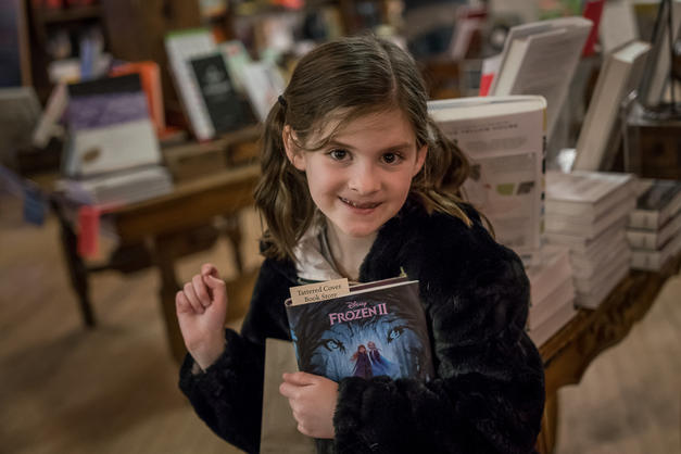 Although she struggles with reading, she adores collecting books and loves going to bookstores
