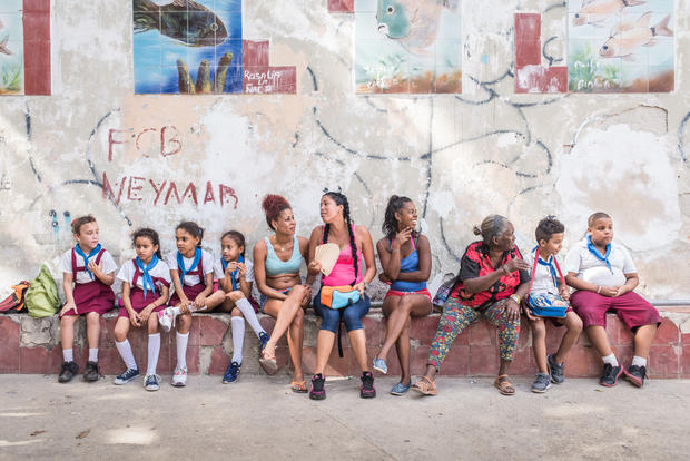Spectators of a religious street performance in Havana