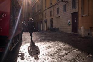 Saverio walking through the streets of Siena