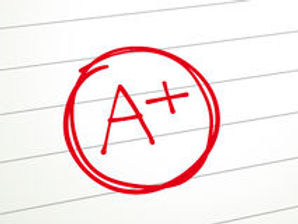 paper-graded-plus-red-pen-close-up-look-lined-43317729.jpg