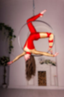 Beautiful aerialist girl doing acrobatic