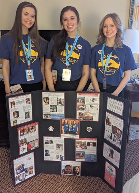 Sydnee, Brooke and Carmen with FCCL competition/presentation board, TX
