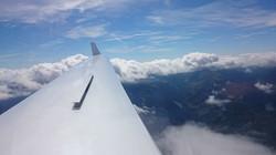 Descending below the clouds