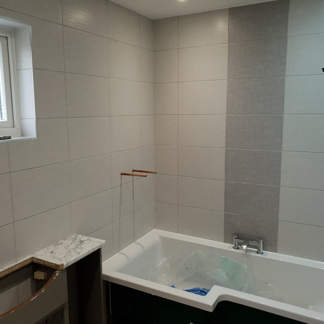 New bath in, new tiles up & vanity ready for basin