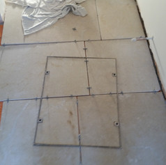 Laying natural stone in an extension, cutting in to man hole cover