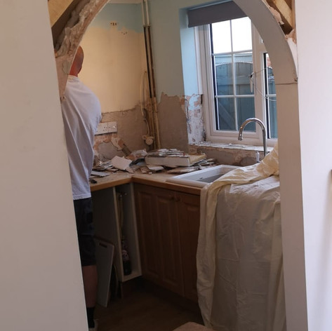 Removing an archway to create more sapce, ready for the new kitchen.