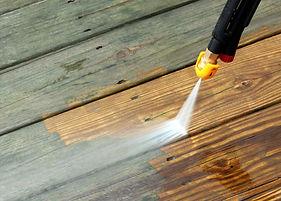 Pressure Wash your deck.
