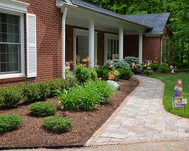 We prune shrubs and mulch beds.