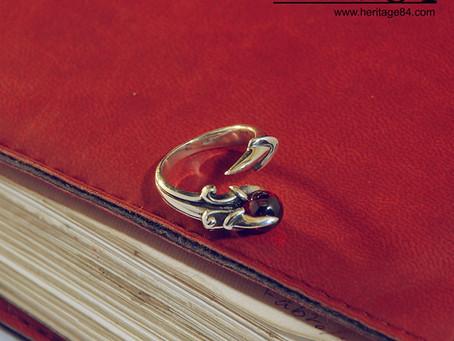 Dragon claw silver ring with garnet