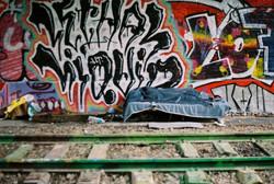 Sleeping under the railway bridge