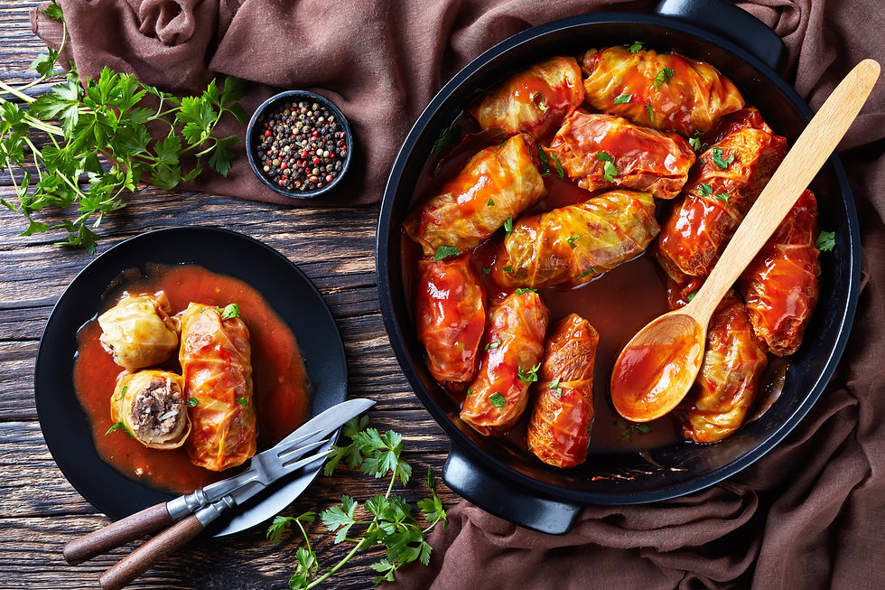 cabbage rolls stuffed with ground beef and rice and cooked to perfection with a tangy toma