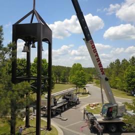 Tower install crane lifting over curb pi