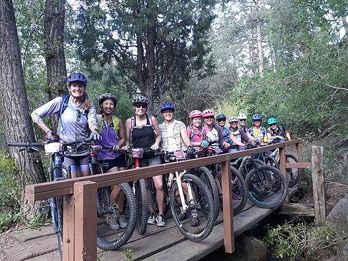 Photo of women on a group mountain bike ride