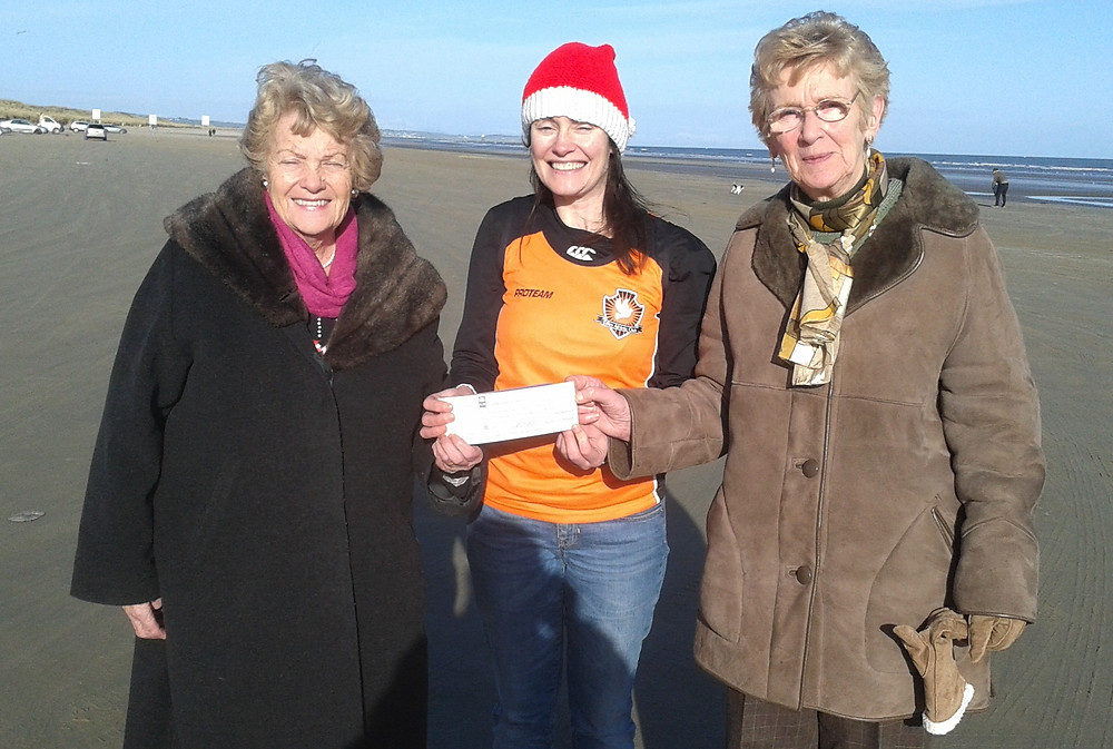Peggy n Chrissy recieving cheque.jpg
