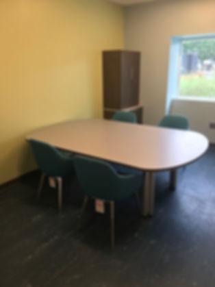 small conference room table and chairs.j