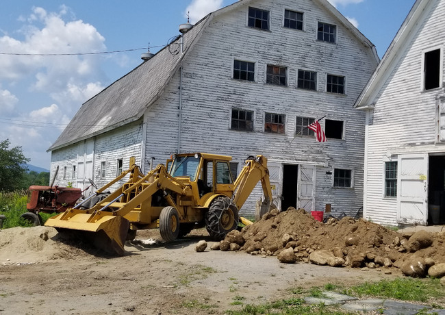 Digging the trench for the underground electric feed for the barn