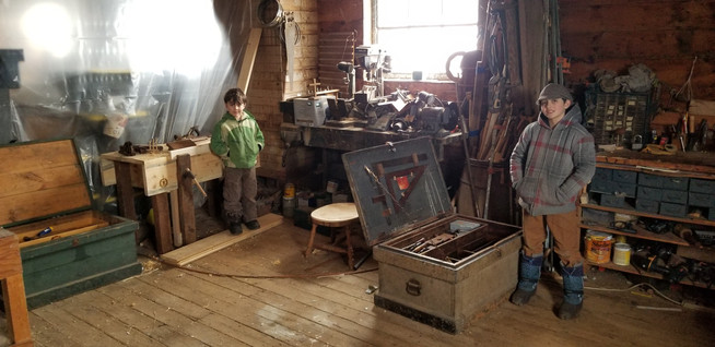 boys in shop with new  workbench and tool boxes