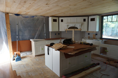 Kitchen cabinets, island and vent hood