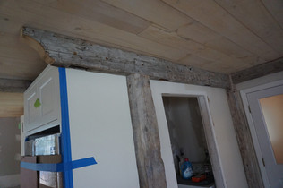 reclaimed beams installed in new kitchen