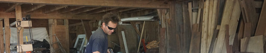 Antique beams being cut for installation