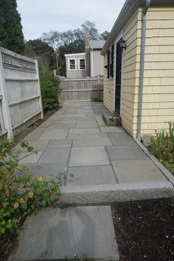 The side blue-stone patio