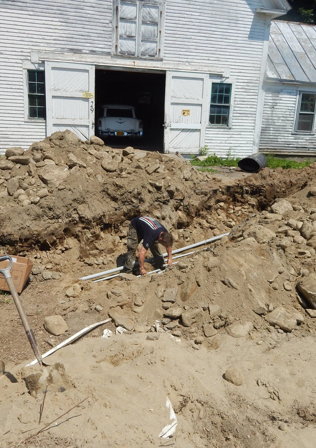 Laying underground pipes for electric and water to barn