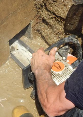 cutting holes in barn foundation for ele