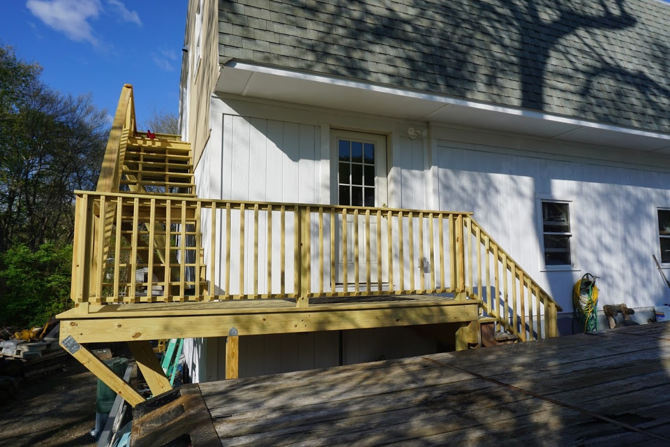 Second floor stairs with deck