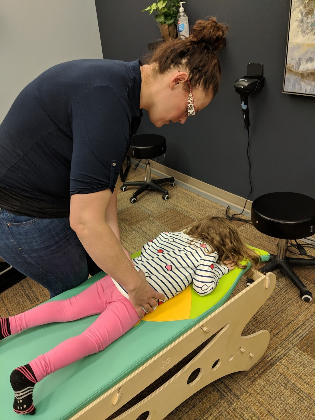 adjustment on the pediatric table