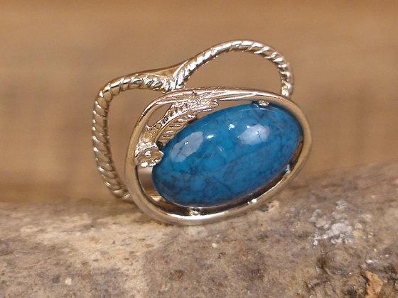 Attache foulard centre pierre bleue et Plume