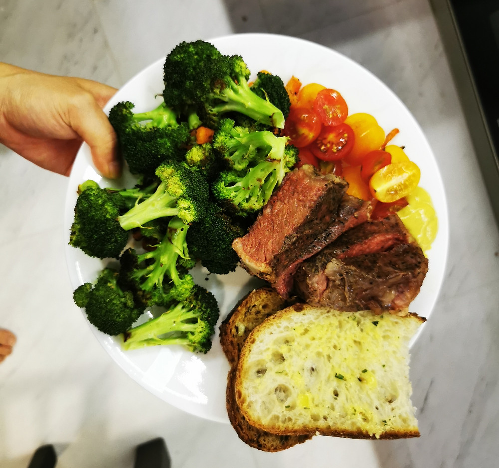 Dinner plate with sirloin steak and bread
