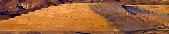 Open pit mine heap pad lifts in Nevada.j