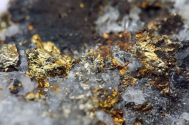 Coarse gold in ore at open pit gold mine site