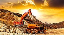 Shovel loads ore at mine site